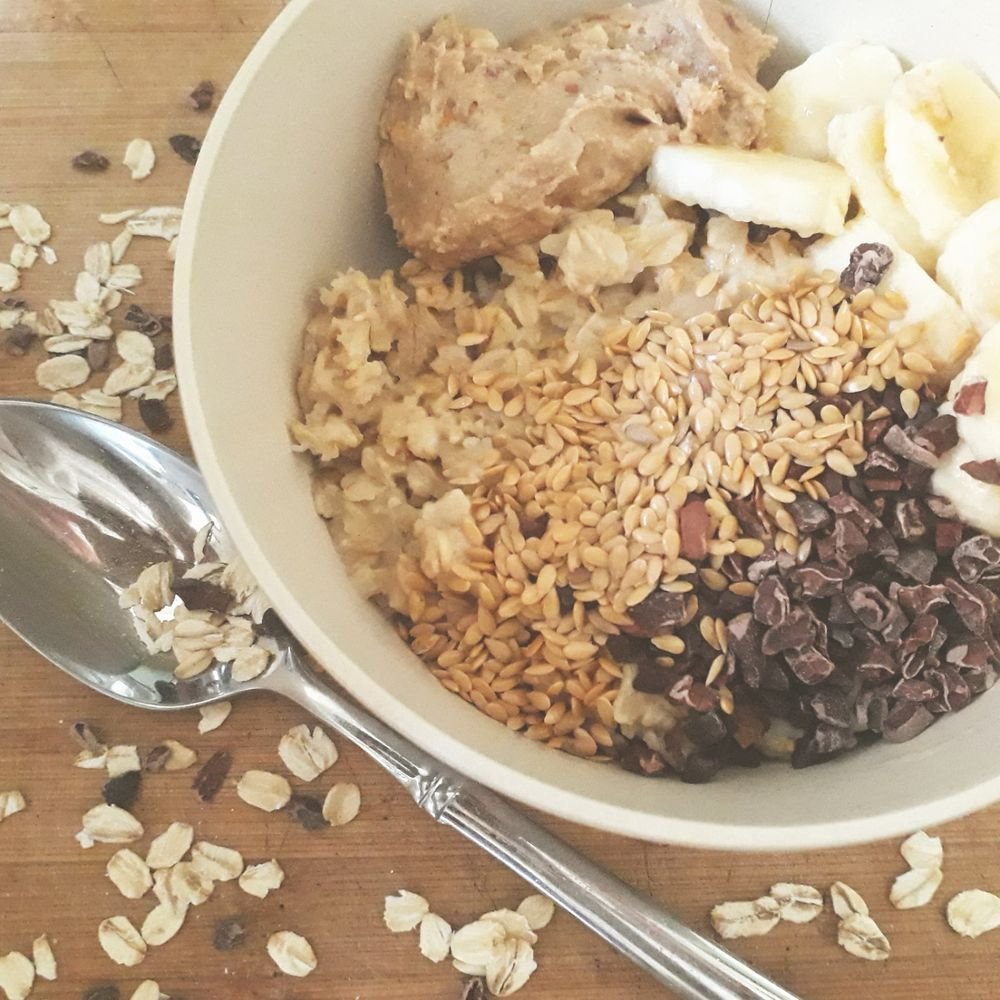 Porridge makes a great pre-/post- workout brekkie. Oats release energy slowly to keep you going, are a great source of fibre and help lower cholesterol. Max out nutritional benefits with toppings such as peanut butter (protein, fats), linseed (omega 3, more protein) and banana and cacao nibs for vitamins and minerals.
